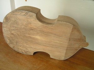 The back trimmed flush with the ribs and the purfling inlaid.